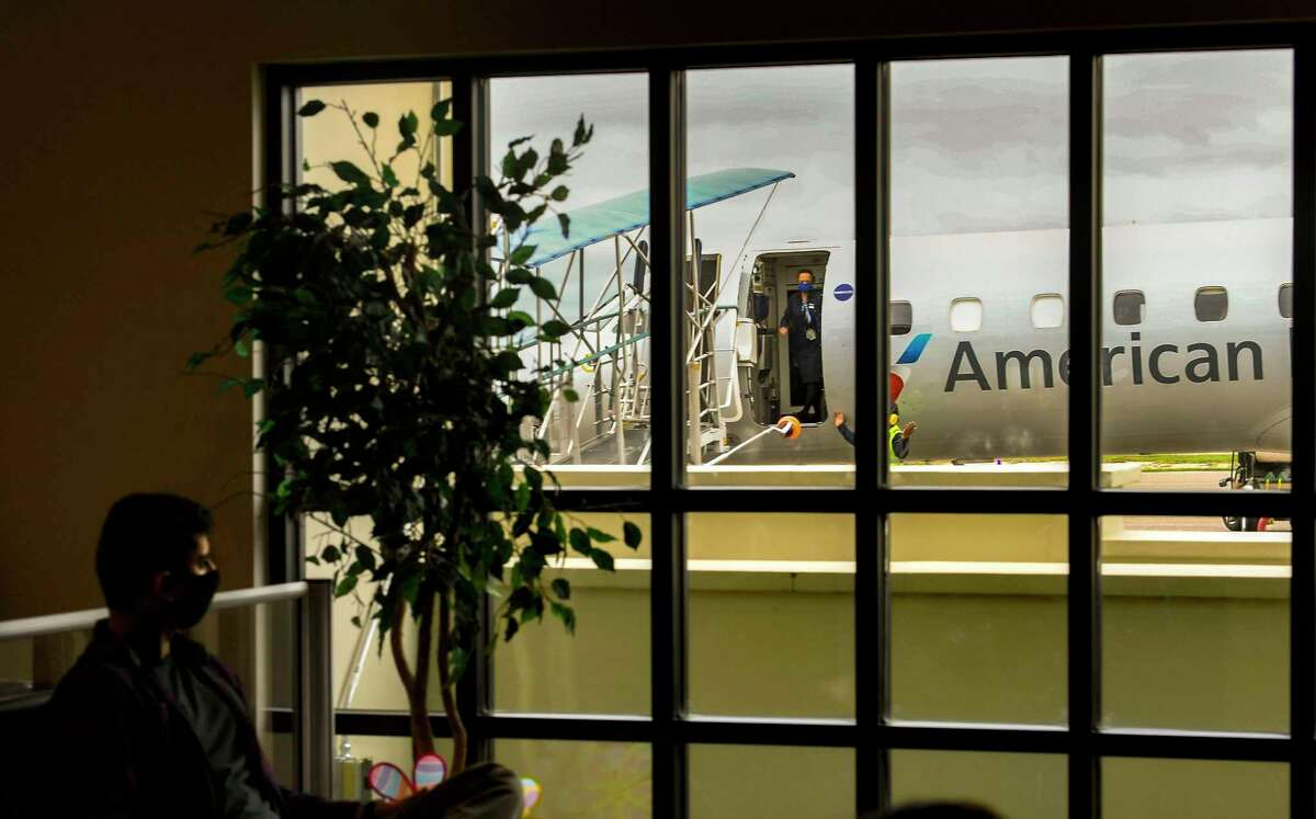 An American Eagle Embraer jet awaits passengers at Del Rio International Airport. American Airlines plans to suspend Del Rio service for a month, starting Oct. 7, and it soon will announce whether to end the flights for good.
