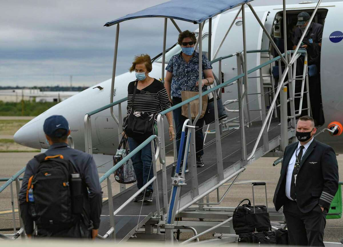 Passengers disembark from an American Eagle Embraer jet at Del Rio International Airport on Thursday, Sept. 10, 2020. American Airlines has since suspended service at the airport.