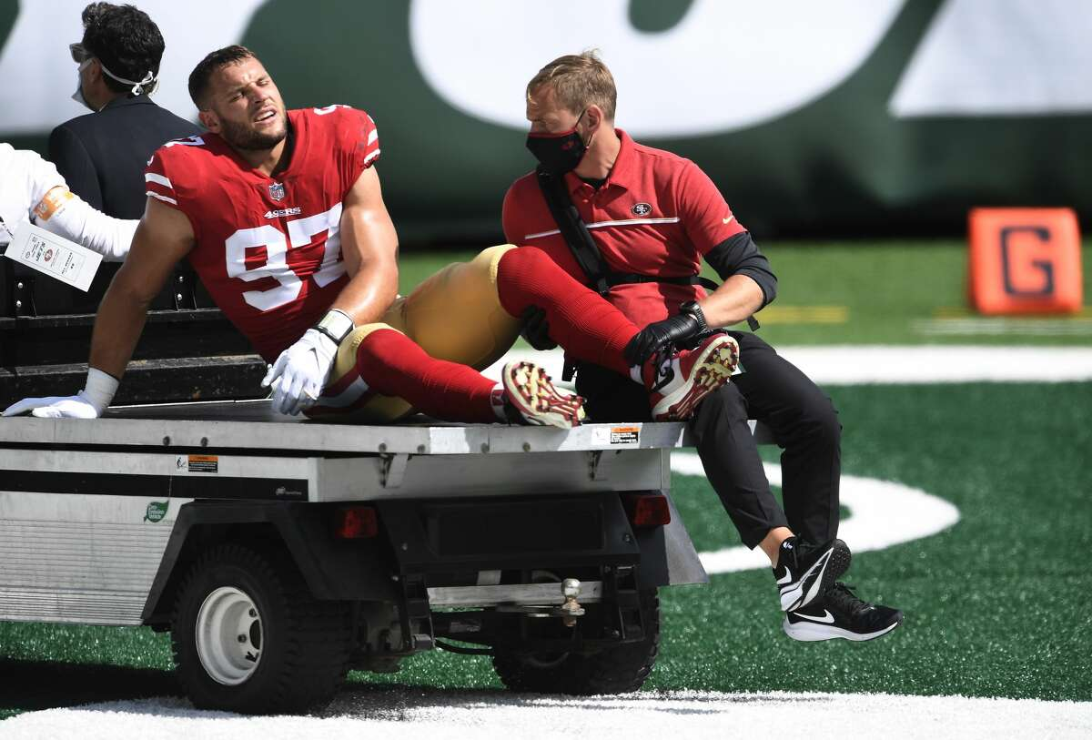 Nick Bosa #97 of the San Francisco 49ers is carted off the field after sustaining an injury during the first half against the New York Jets at MetLife Stadium on September 20, 2020 in East Rutherford, New Jersey. (Photo by Sarah Stier/Getty Images)