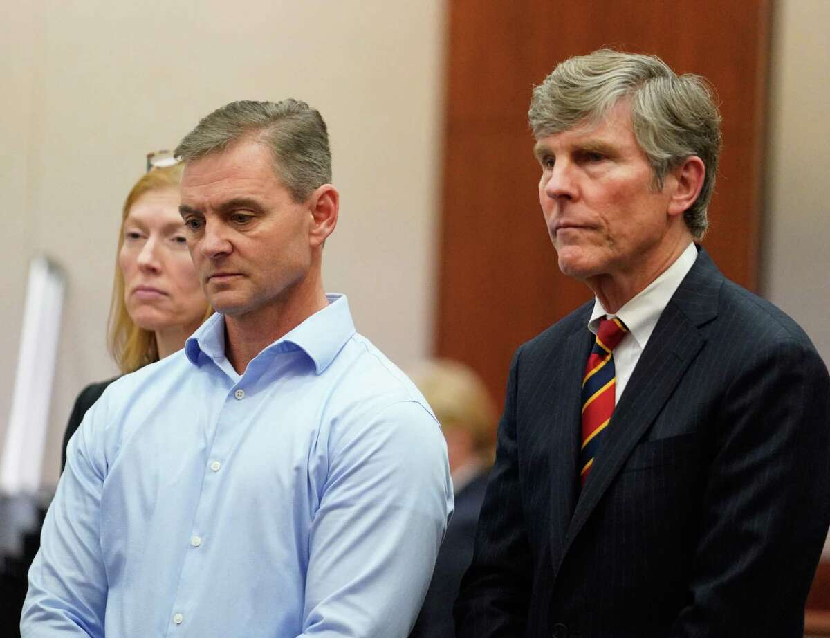 Leslie Comardelle, former Arkema plant manager in Crosby, center, and his defense attorneys Heather Peterson and Paul Nugent, are shown during the Arkema Inc. criminal trial at Harris County Criminal Courthouse 1201 Franklin St., Thursday, Feb. 27, 2020.