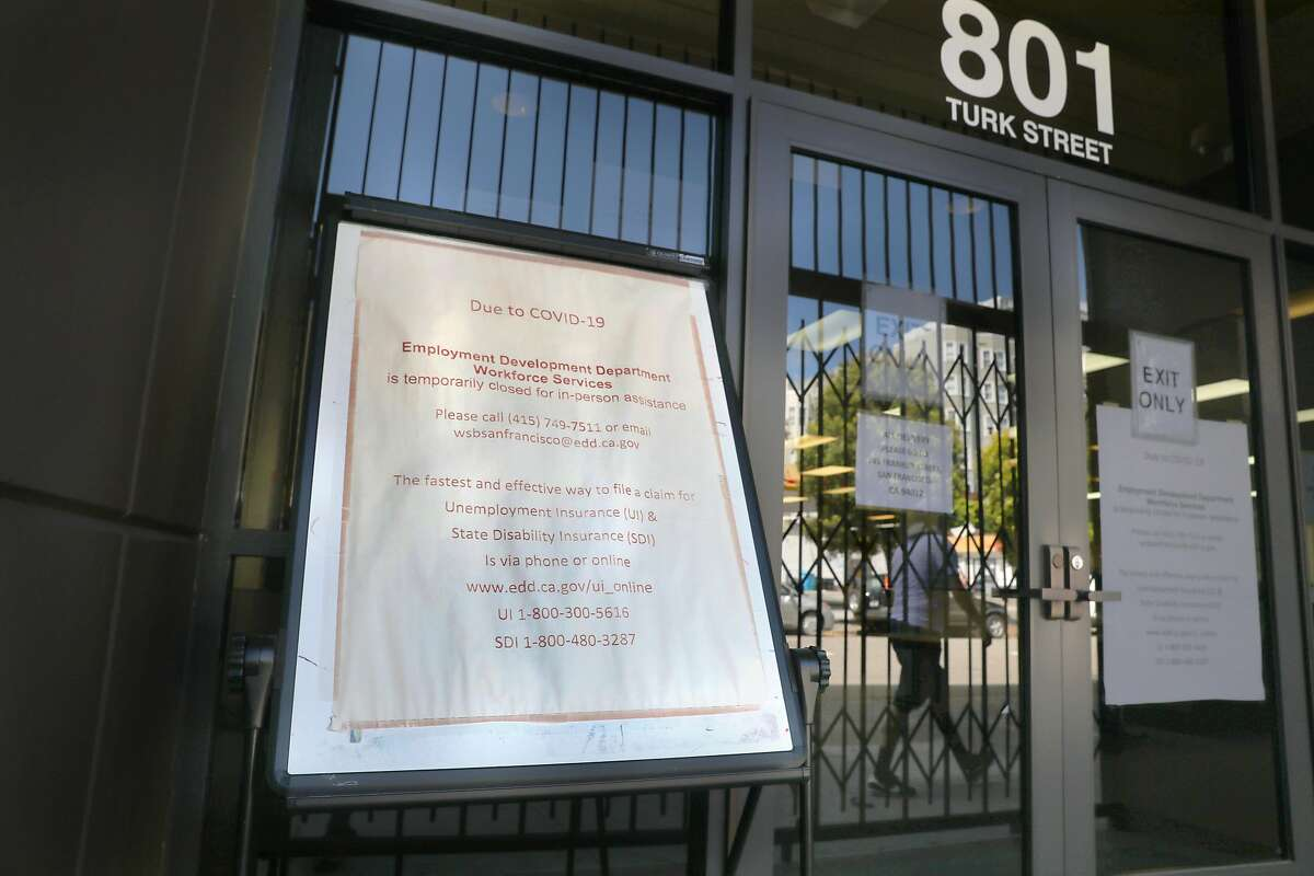 The Turk St. entrance is closed off at the California Employment Development Department seen on Tuesday, May 19, 2020, in San Francisco, Calif.