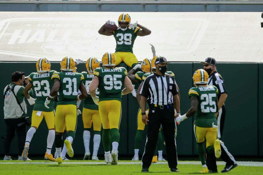 Green Bay Packers' Chandon Sullivan celebrates his interception and touchdown return during the second half of an NFL football game against the Detroit Lions Sunday, Sept. 20, 2020, in Green Bay, Wis. (AP Photo/Mike Roemer) / Copyright 2020 The Associated Press. All rights reserved.