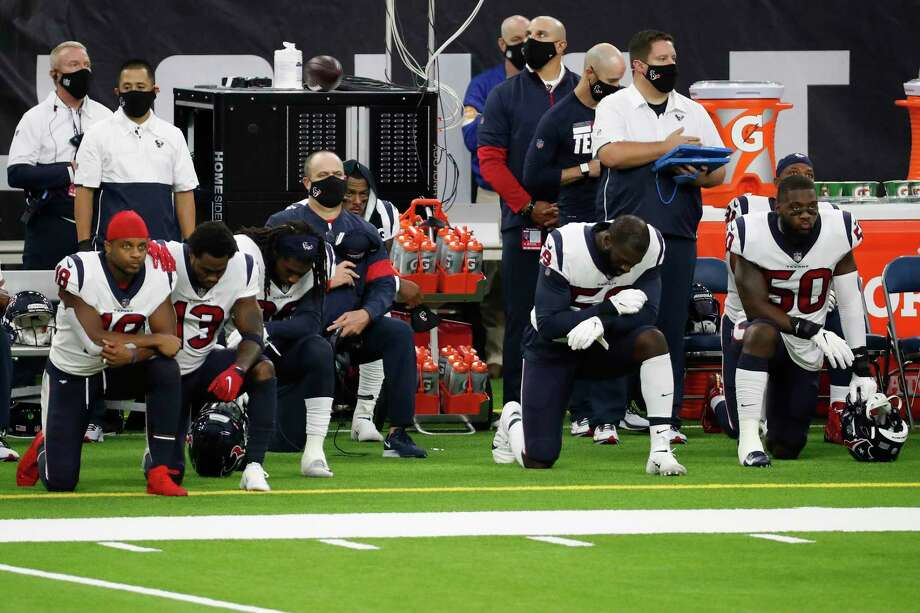 PHOTO: More photos of the Texans and Ravens sidelines during the national anthem on Sunday Houston Texans head coach Bill O'Brien, center kneels with his players during the national anthem before an NFL football game against the Baltimore Ravens at NRG Stadium on Sunday, Sept. 20, 2020, in Houston. Photo: Brett Coomer, Staff Photographer / © 2020 Houston Chronicle