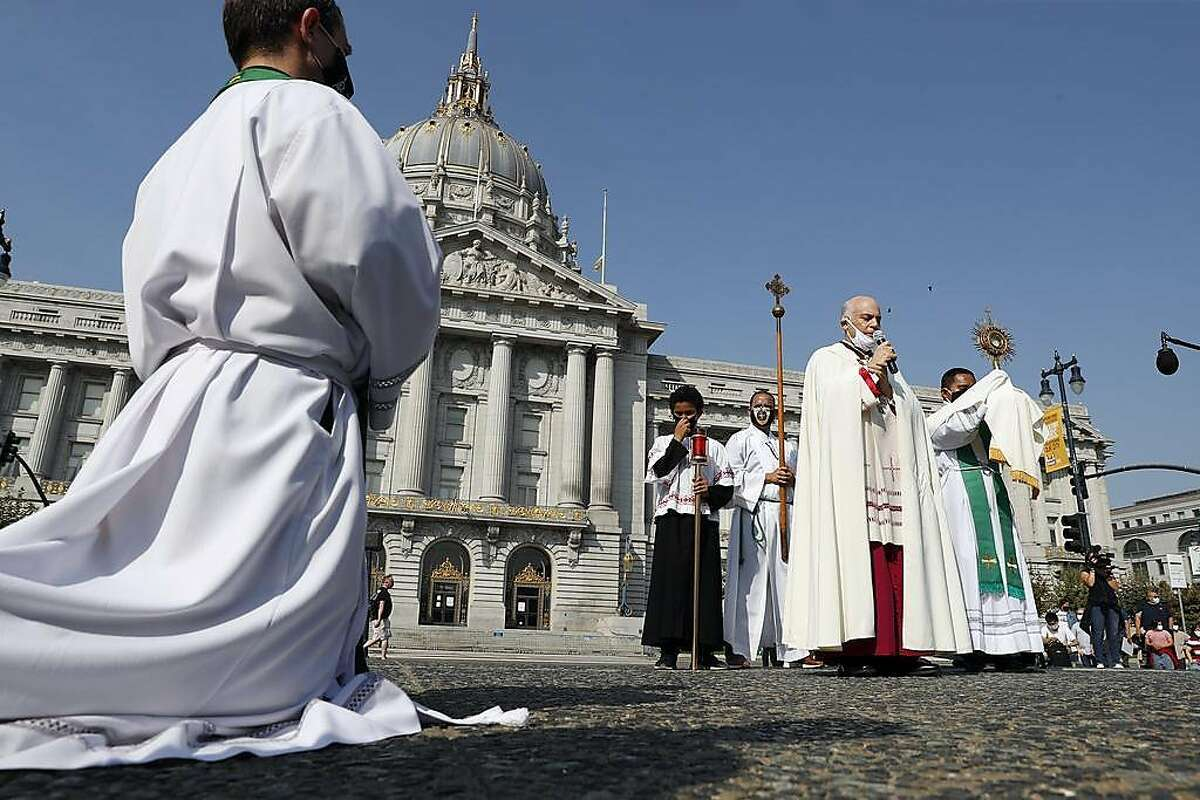 Archbishop Salvatore J. Cordileone speaks to Catholic parishioners at City Hall before leading a procession to St, Mary's Cathedral to protest against coronavirus restrictions in San Francisco, Calif., on Sunday, September 20, 2020.
