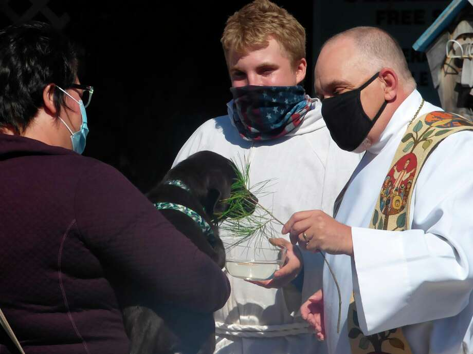"""Members of the clergy blessed pets ranging from dogs and cats to rabbits and chickens at Circle Rocking """"S"""" Children's Farm in Free Soil this weekend.(Scott Fraley/News Advocate)"""