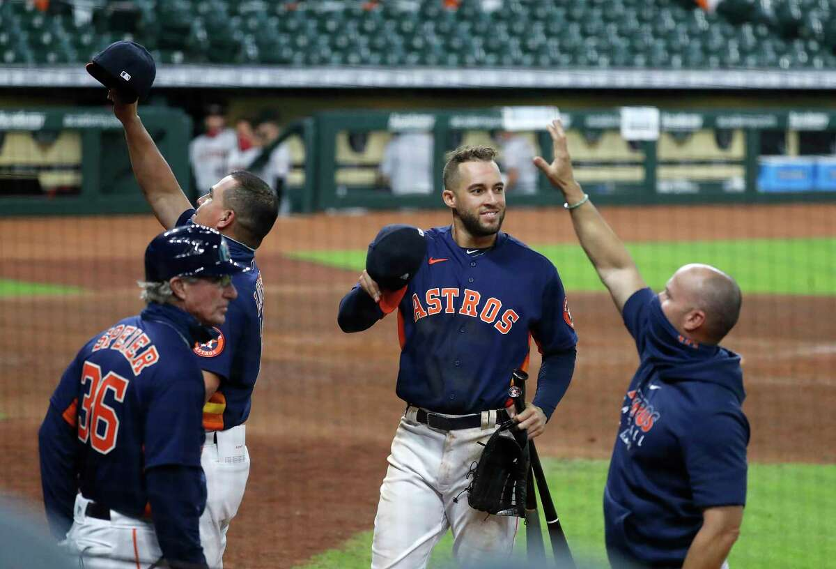 Houston Astros George Springer (4) waves to the fan cutouts as he and the rest of the team celebrated the Astros 3-2 win over the Arizona Diamondbacks to finish the last regular season home game at Minute Maid Park, Sunday, September 20, 2020, in Houston.