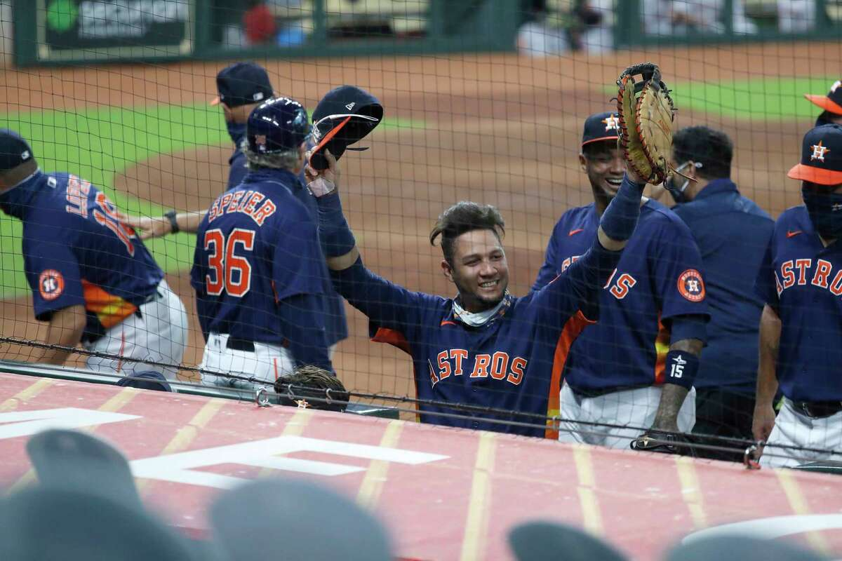 Houston Astros Yuli Gurriel (10) waves to the fan cutouts as he and the rest of the team celebrated the Astros 3-2 win over the Arizona Diamondbacks to finish the last regular season home game at Minute Maid Park, Sunday, September 20, 2020, in Houston.