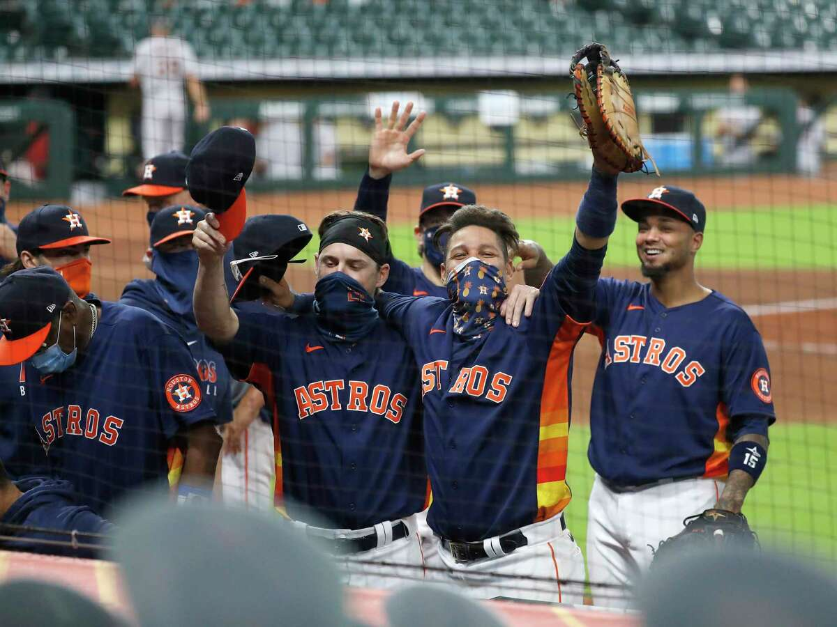 Houston Astros Yuli Gurriel (10) and Josh Reddick wave to the fan cutouts as they and the rest of the team celebrated the Astros 3-2 win over the Arizona Diamondbacks to finish the last regular season home game at Minute Maid Park, Sunday, September 20, 2020, in Houston.