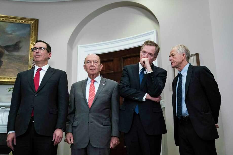 Treasury Secretary Steve Mnuchin, left, Commerce Secretary Wilbur Ross, U.S. Trade Representative Robert Lighthizer and White House National Trade Council Director Peter Navarro attend a White House signing event in March 2018. Photo: Washington Post Photo By Jabin Botsford / The Washington Post