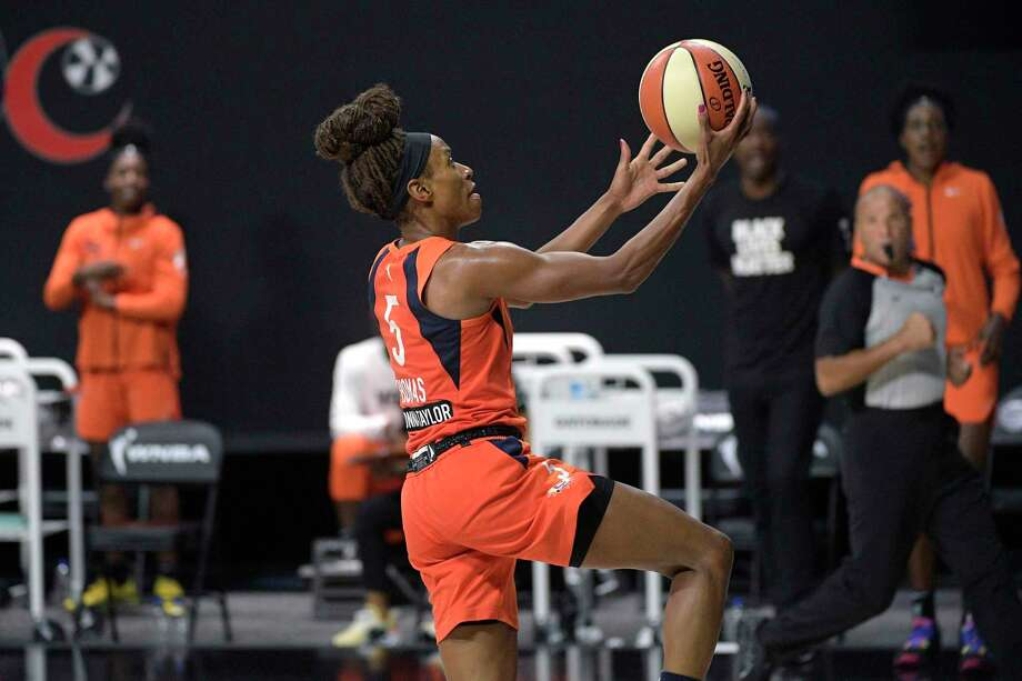 Sun guard Jasmine Thomas goes up for a breakaway basket during the second half against the Aces on Sunday. Photo: Phelan M. Ebenhack / Associated Press / Copyright 2020 The Associated Press. All rights reserved.