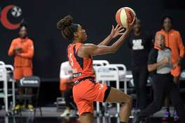 Sun guard Jasmine Thomas goes up for a breakaway basket during the second half against the Aces on Sunday.