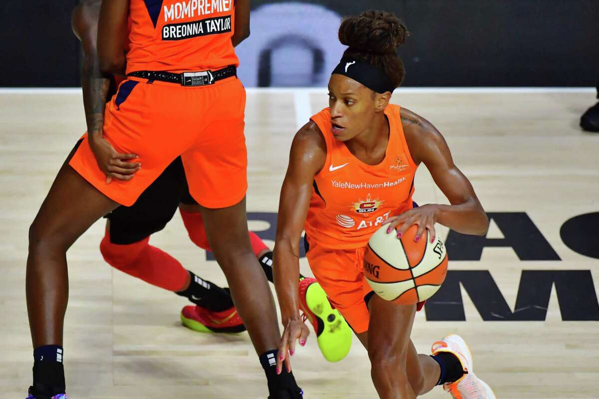 Jasmine Thomas of the Connecticut Sun drives to the basket against the Aces on Sunday.