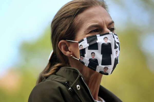 Lieutenant Governor Susan Bysiewicz wears a Ruth Bader Ginsburg mask during a tribute to the late Supreme Court justice outside the Superior Courthouse in Stamford , Conn. on Sunday, September 20, 2020.