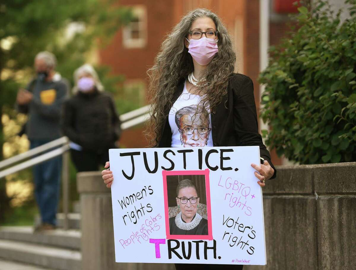 Shira Tarantino, of Stamford, attends a ceremony honoring late Supreme Court Justice Ruth Bader Ginsburg outside the Superior Courthouse in Stamford , Conn. on Sunday, September 20, 2020. Stamford resident Shira Tarantino a member of Suburban Women Against Trump, came out to the memorial
