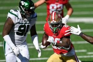 EAST RUTHERFORD, NEW JERSEY - SEPTEMBER 20: Jerick McKinnon #28 of the San Francisco 49ers carries the ball as John Franklin-Myers #91 of the New York Jets defends during the second half at MetLife Stadium on September 20, 2020 in East Rutherford, New Jersey. (Photo by Sarah Stier/Getty Images)