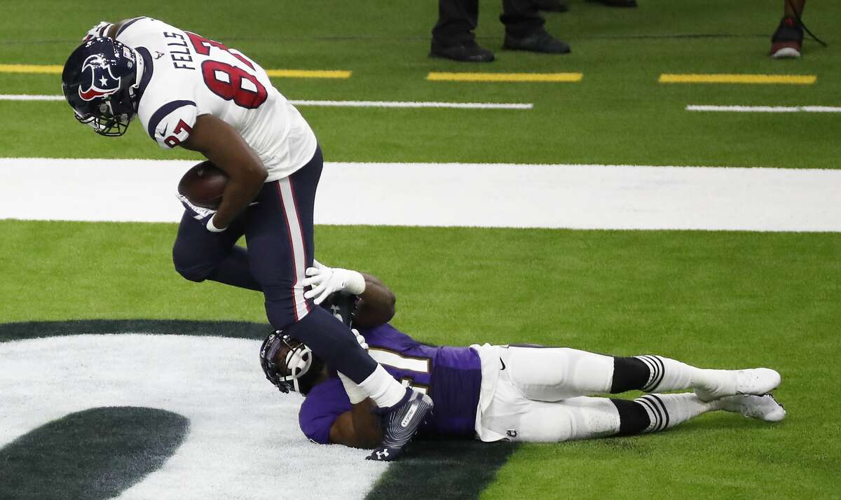 Houston Texans tight end Darren Fells (87) scores a touchdown over Baltimore Ravens defensive back Anthony Levine (41) during the first half of an NFL football game at NRG Stadium on Sunday, Sept. 20, 2020, in Houston.