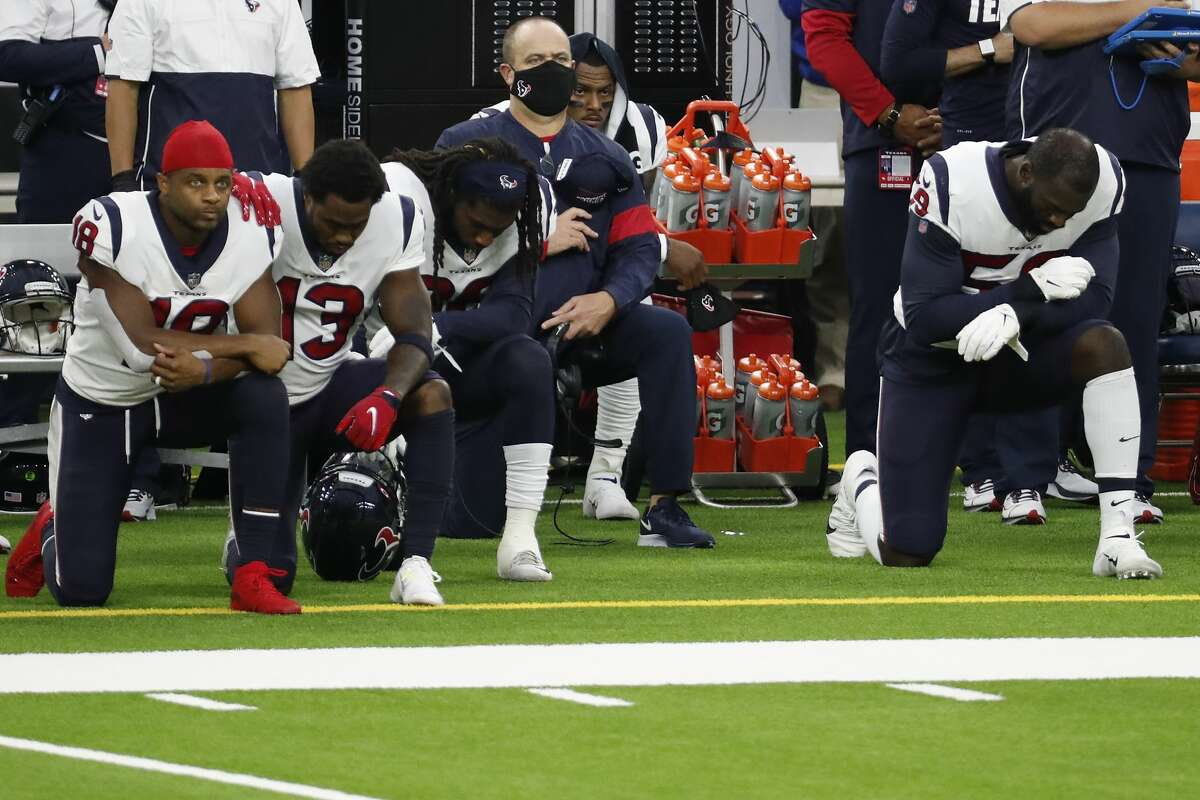 Houston Texans head coach Bill O'Brien, center kneels with his players during the national anthem before an NFL football game against the Baltimore Ravens at NRG Stadium on Sunday, Sept. 20, 2020, in Houston.