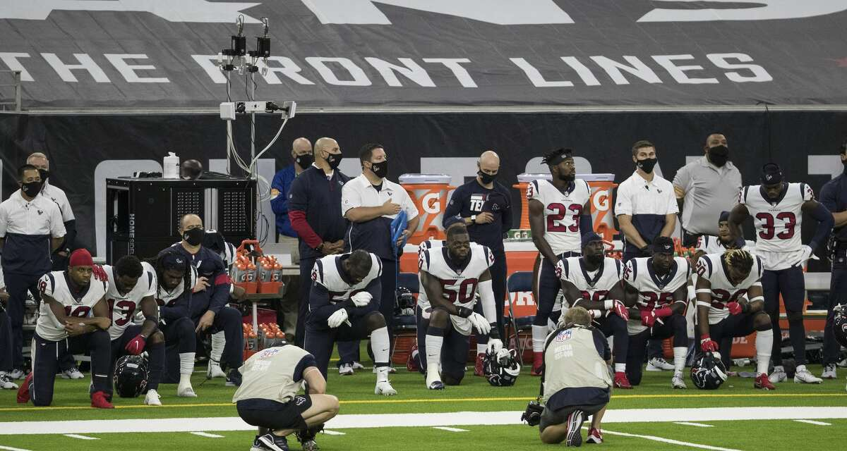 Several Houston Texans players, including head coach Bill O'Brien, take a knee during the national anthem before an NFL football game against the Baltimore Ravens at NRG Stadium on Sunday, Sept. 20, 2020, in Houston.