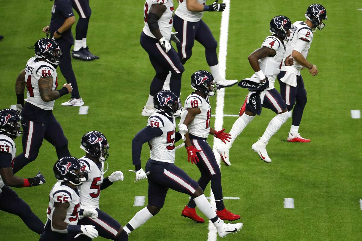 Houston Texans quarterback DeShaun Watson (4) runs across the field while warming up with his teammates before an NFL football game against the Baltimore Ravens at NRG Stadium on Sunday, Sept. 20, 2020, in Houston.