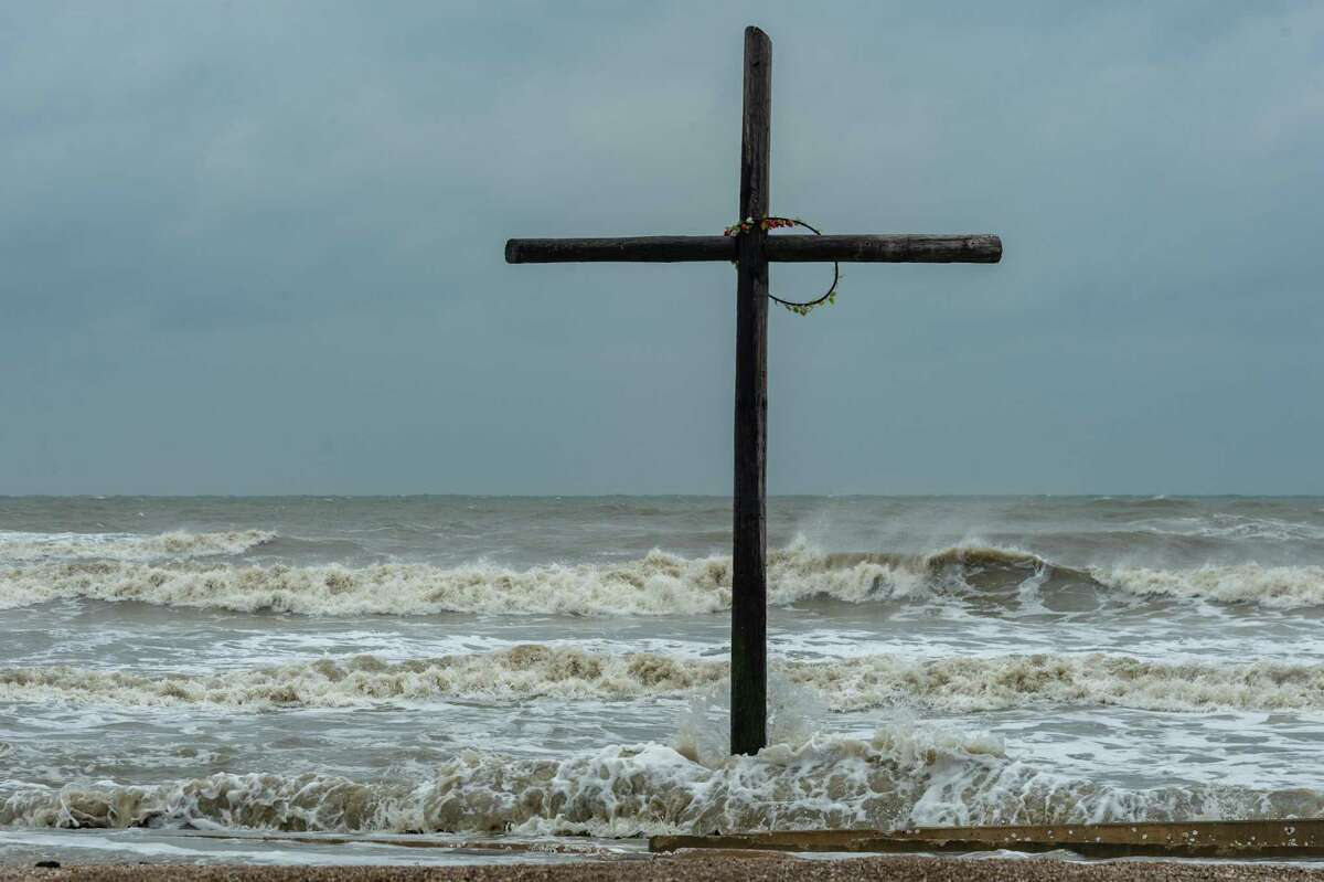 The cross that stands on the beach near the intersection of Highway 124 and Highway 87 gets buffeted by the high seas brought on by Beta. Tropical Storm Beta is still several hundred miles south of Southeast Texas, but the wind and waves are already high on the Bolivar Peninsula. Photo made on September 20, 2020. Fran Ruchalski/The Enterprise