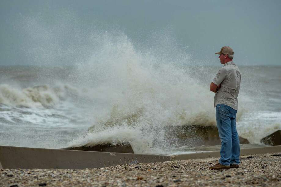 Cole Broom stands on the beach near the intersection of Highway 124 and Highway 87 on the Bolivar Peninsula watching the rough surf. Tropical Storm Beta is still several hundred miles south of Southeast Texas, but the wind and waves are already high on the Bolivar Peninsula. Photo made on September 20, 2020.  Fran Ruchalski/The Enterprise Photo: Fran Ruchalski, The Enterprise / The Enterprise / © 2020 The Beaumont Enterprise