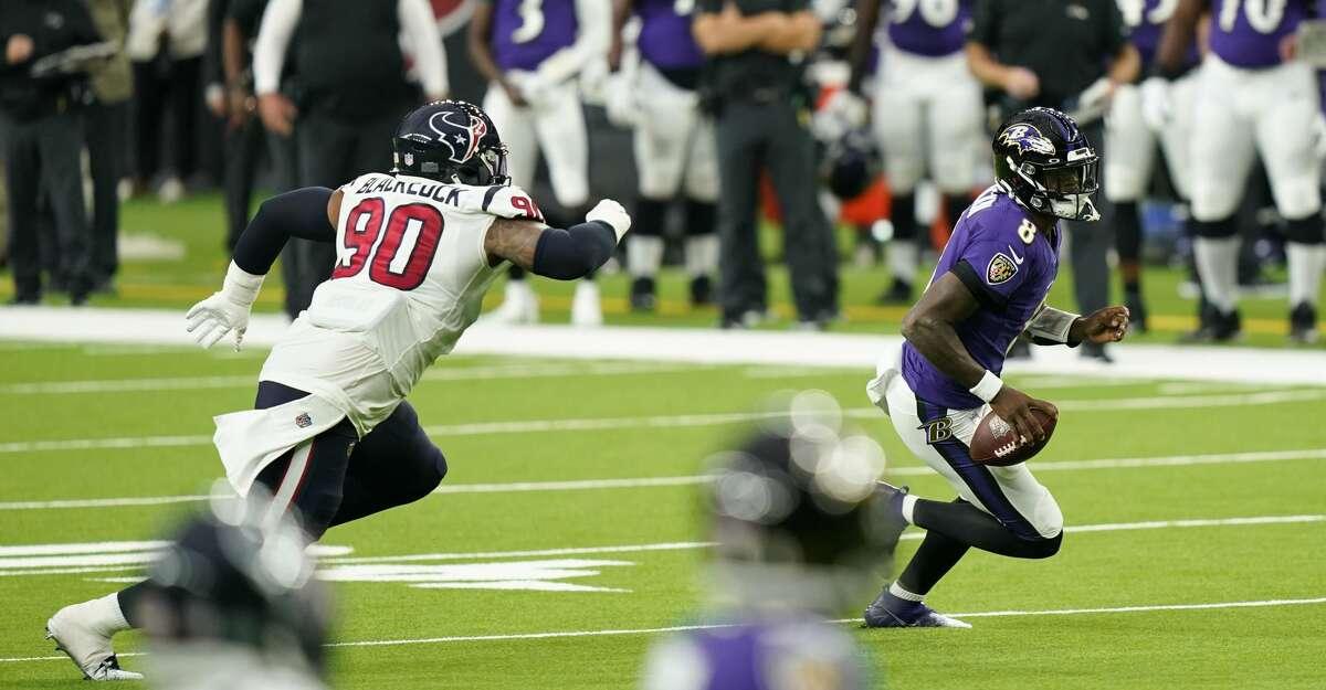Baltimore Ravens quarterback Lamar Jackson (8) runs from Houston Texans defensive tackle Ross Blacklock (90) during the first half of an NFL football game Sunday, Sept. 20, 2020, in Houston. (AP Photo/David J. Phillip)