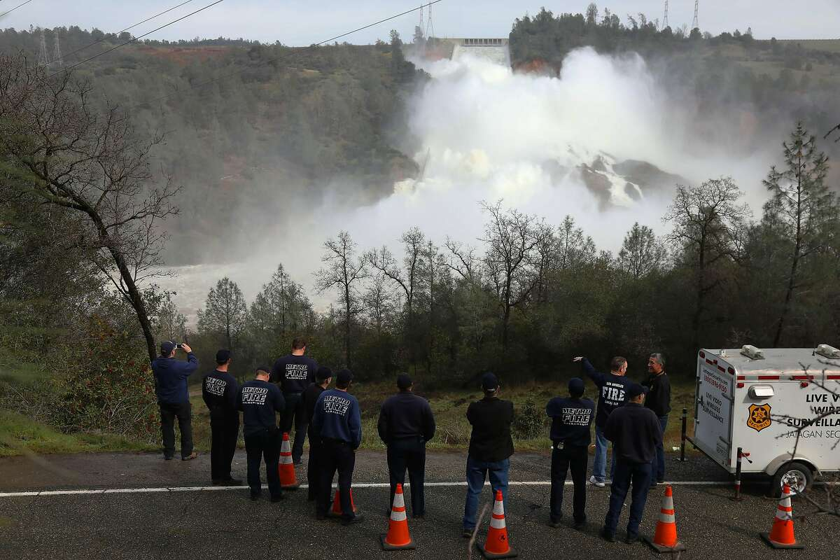 FILE - Water escapes from the Oroville Dam in California after part of the structure collapsed, Feb. 13, 2017. The same manufactured landscapes that have enabled California�s tremendous growth, building the state into a $3 trillion economy that is home to one in 10 Americans, have also left it more exposed to climate shocks, experts say. (Jim Wilson/The New York Times)