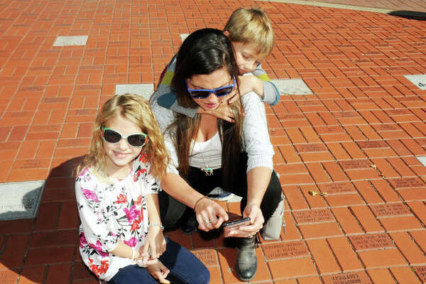 Wiedman family members stop at Lincoln Douglas Square during Saturday's scavenger hunt.