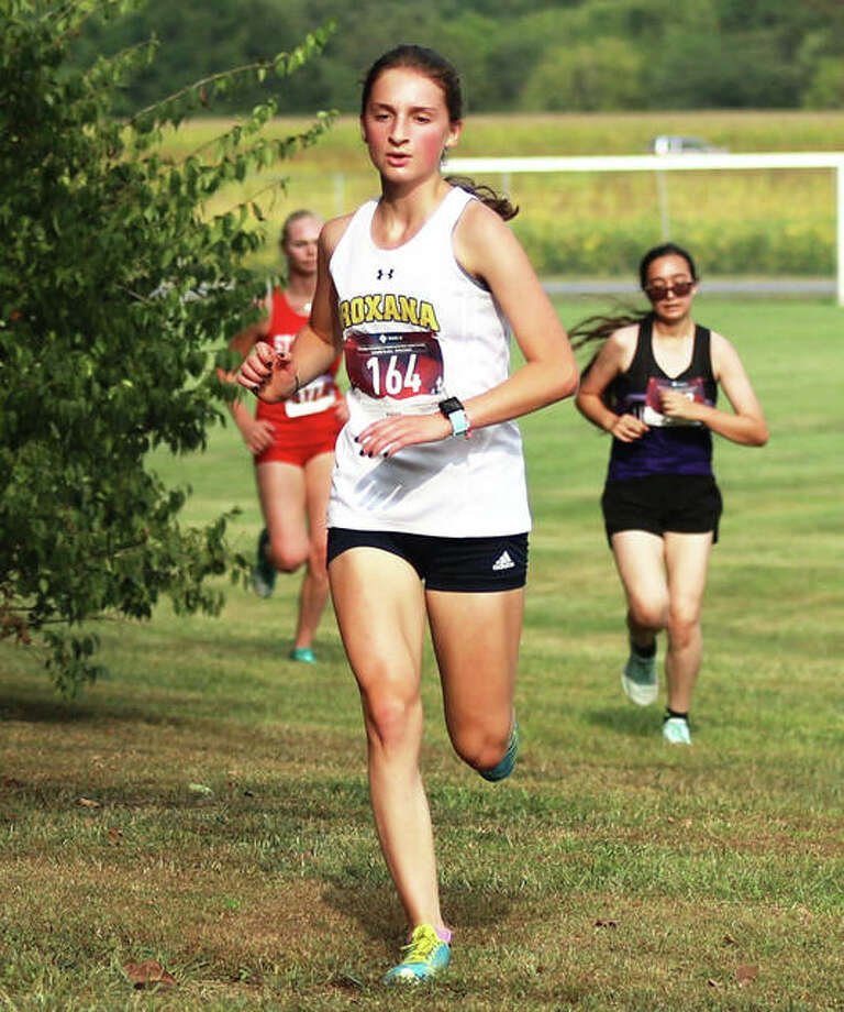 Roxana sophomore Gabrielle Woodruff runs to a personal record time Tuesday at the Staunton Invite at the Staunton Soccer Complex. Woodruff came back Saturday with another PR in the Highland Invite at Alhambra. Photo: Greg Shashack / The Telegraph