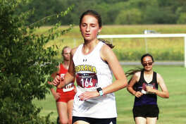 Roxana sophomore Gabrielle Woodruff runs to a personal record time Tuesday at the Staunton Invite at the Staunton Soccer Complex. Woodruff came back Saturday with another PR in the Highland Invite at Alhambra.