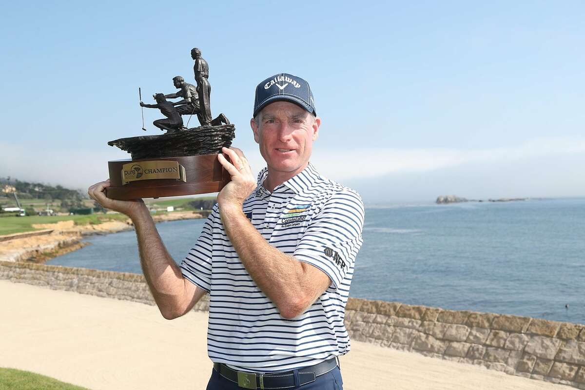 PEBBLE BEACH, CALIFORNIA - SEPTEMBER 20: Jim Furyk celebrates with the trophy after winning the final round of the PURE Insurance Championship at the Pebble Beach Golf Links on September 20, 2020 in Pebble Beach, California. (Photo by Jed Jacobsohn/Getty Images)