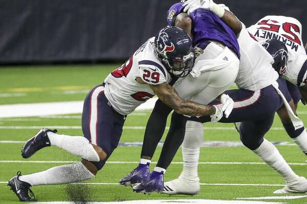 Houston Texans cornerback Phillip Gaines (29) tackles Baltimore Ravens quarterback Lamar Jackson (8) during the third quarter of an NFL football game Sunday, Sept. 20 2020, at NRG Stadium in Houston.