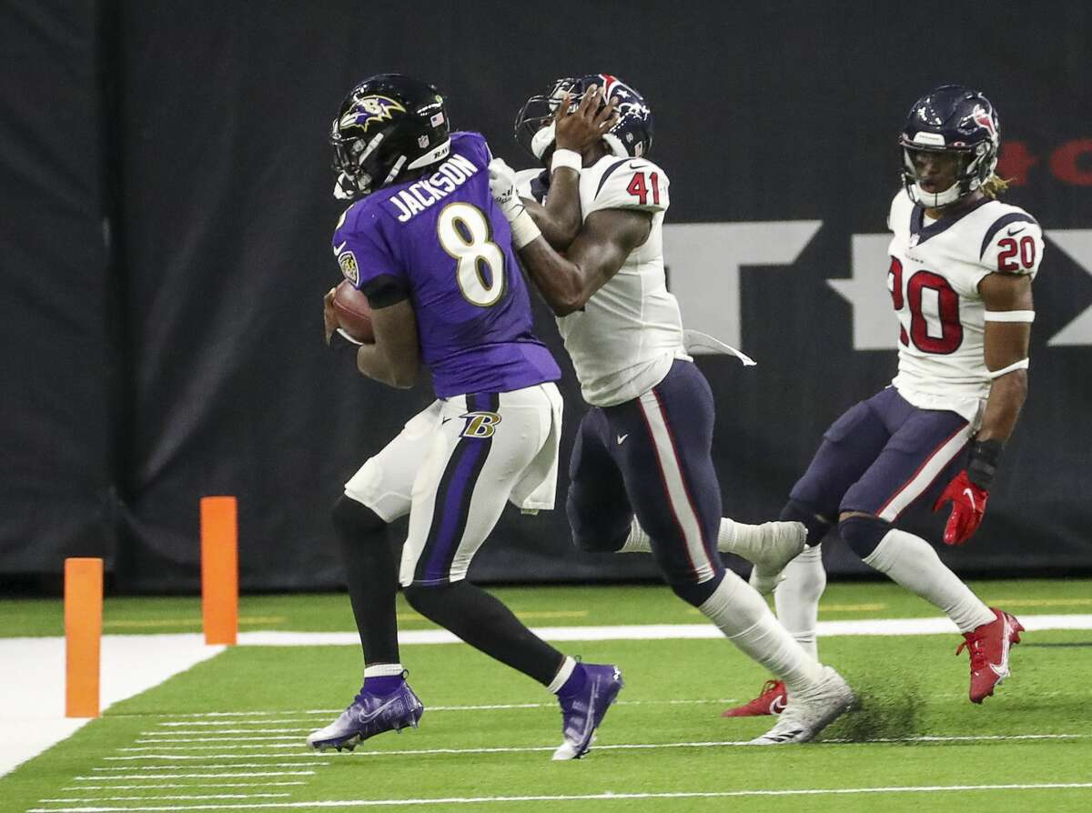 Baltimore Ravens quarterback Lamar Jackson (8) is pushed out of bounds by Houston Texans inside linebacker Zach Cunningham (41) during the fourth quarter of an NFL football game Sunday, Sept. 20 2020, at NRG Stadium in Houston.