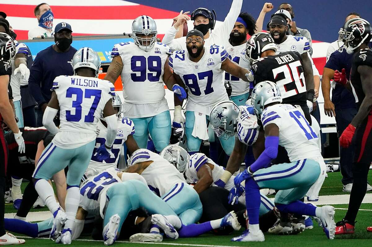 Dallas Cowboys defensive end Everson Griffen (97) reacts with teammates on the bench as defensive back C.J. Goodwin recovers an onside kick late in the fourth quarter against the Atlanta Falcons on Sunday, September 20, 2020 at AT&T Stadium in Arlington, Texas. (Smiley N. Pool/The Dallas Morning News/TNS)
