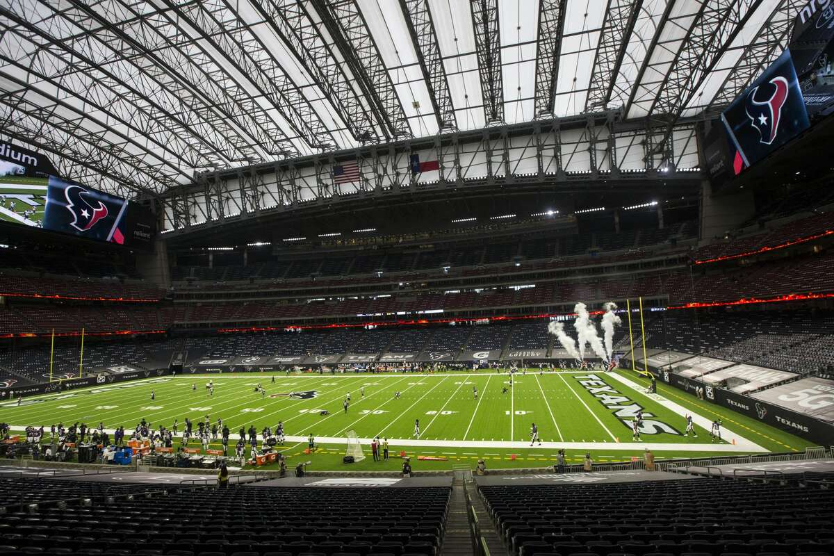 Houston Texans players run out of the tunnel for the first home game of the season at NRG Stadium on Sunday, Sept. 20, 2020, in Houston.