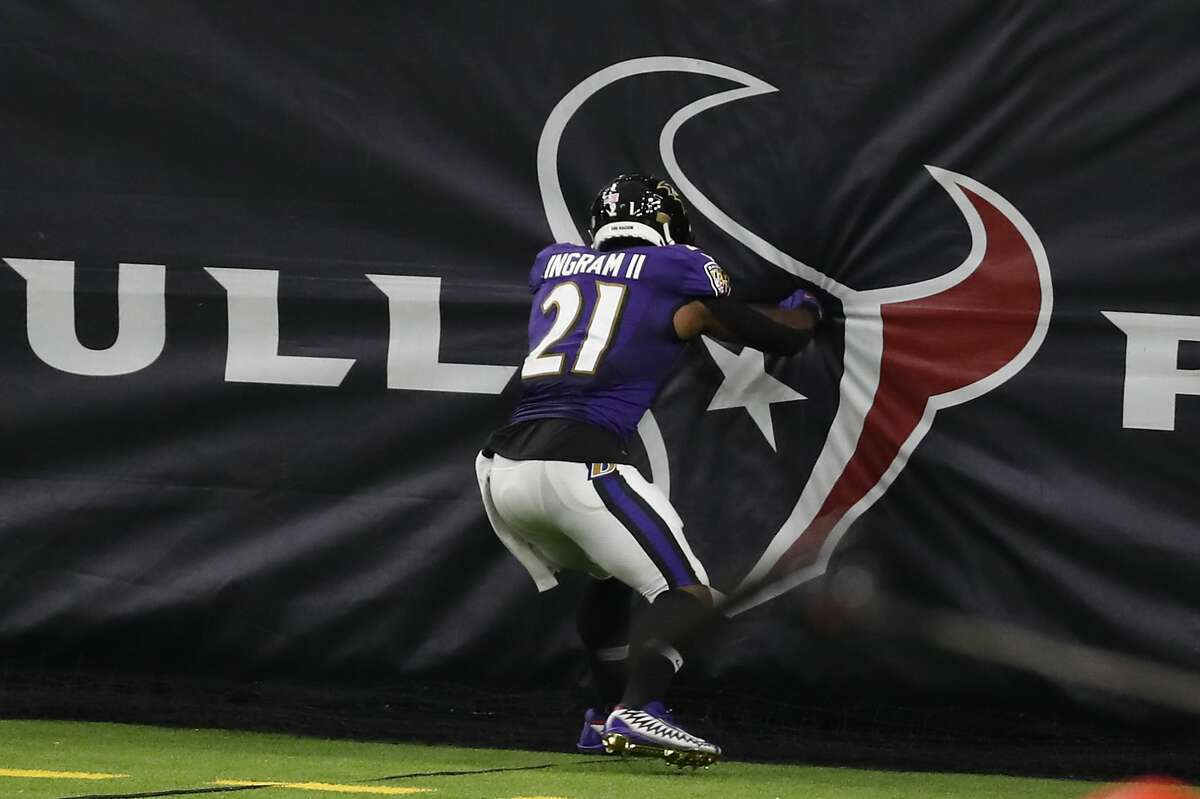 Baltimore Ravens running back Mark Ingram (21) punches the Houston Texans logo after breaking away from the Texans defense for a 30-yard touchdown run during the second half of an NFL football game at NRG Stadium on Sunday, Sept. 20, 2020, in Houston.