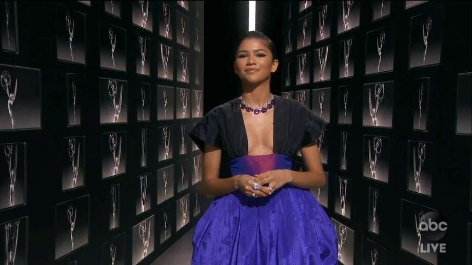 """EMMYS: Zendaya, nominated for Outstanding Lead Actress in a Drama series for her work in """"Euphoria,"""" has chosen to wear a custom Giorgio Armani Privé black matte weave skirt with powder-pink polka dots, paired with a black velvet bandeau top fully embroidered in pearls and crystals to the 72ndEmmy Awards. Photo: Courtesy Photo"""