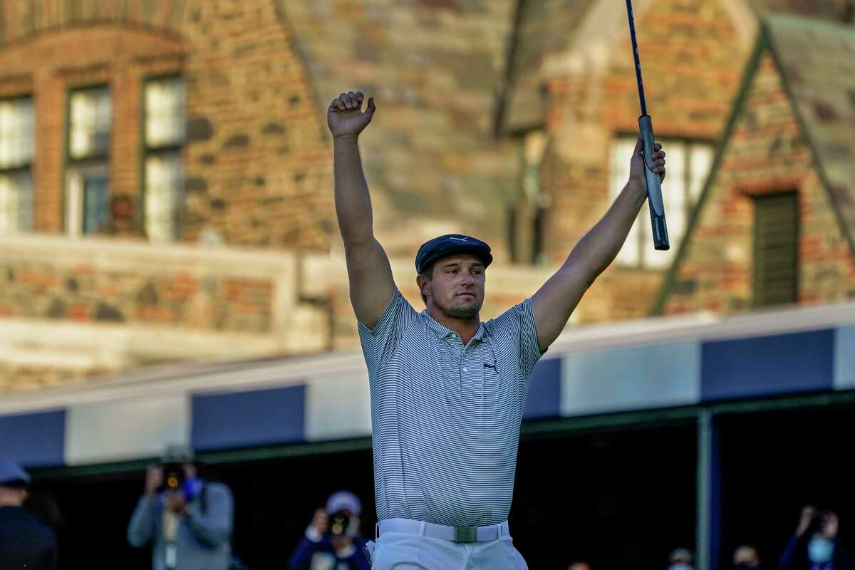Bryson DeChambeau, of the United States, reacts after sinking a putt for par on the 18th hole to win the US Open Golf Championship, Sunday, Sept. 20, 2020, in Mamaroneck, N.Y. (AP Photo/Charles Krupa)
