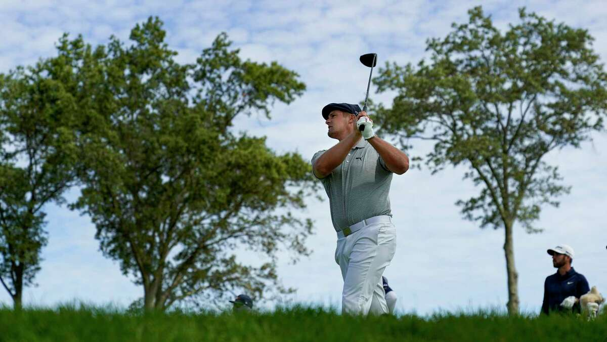 Bryson DeChambeau, of the United States, plays his shot from the fourth tee during the final round of the US Open Golf Championship, Sunday, Sept. 20, 2020, in Mamaroneck, N.Y. (AP Photo/Charles Krupa)