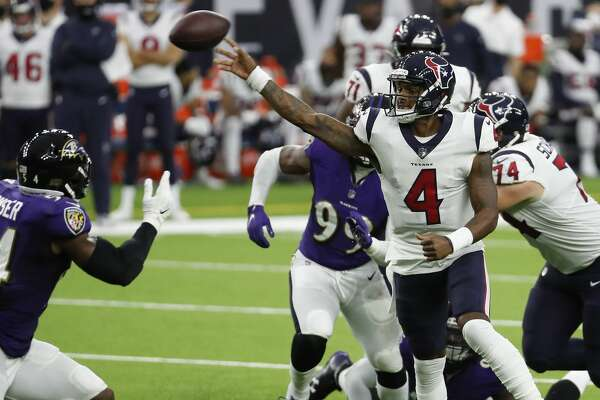 Houston Texans quarterback Deshaun Watson (4) tosses a pass over Baltimore Ravens linebacker Tyus Bowser (54) during the second half of an NFL football game at NRG Stadium on Sunday, Sept. 20, 2020, in Houston.