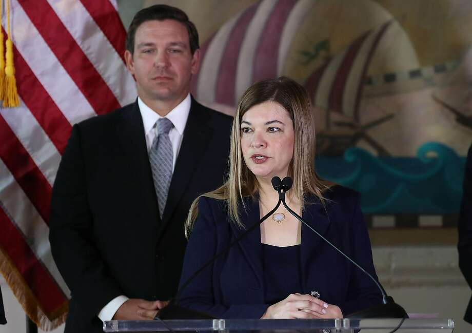 Newly sworn-in Florida Gov. Ron DeSantis stands behind Barbara Lagoa as she speaks after he named her to the Florida Supreme Court on January 9, 2019 in Miami, Florida. (Joe Raedle/Getty Images/TNS) Photo: Joe Raedle, TNS