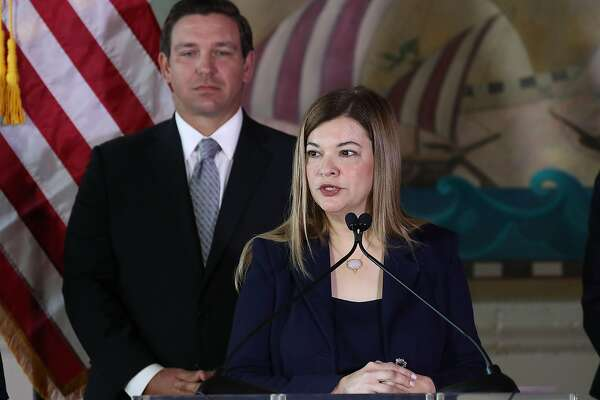 Newly sworn-in Florida Gov. Ron DeSantis stands behind Barbara Lagoa as she speaks after he named her to the Florida Supreme Court on January 9, 2019 in Miami, Florida. (Joe Raedle/Getty Images/TNS)