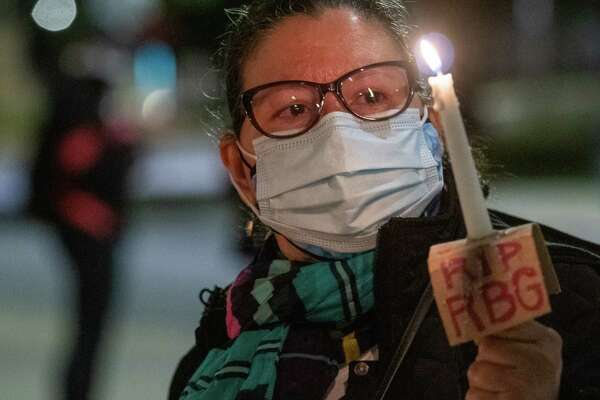 Patty Cestero holds a candle during a vigil outside the New York State Court of Appeals building in Albany, NY, on Saturday, Sept. 19, 2020 to honor Supreme Court Justice Ruth Bader Ginsburg who died on Friday, Sept. 18 (Jim Franco/special to the Times Union.)