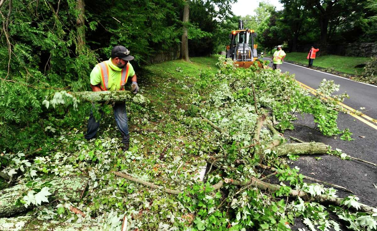 A Greenwich DPW crew continues to cleans up fallen trees and debris left in the wake of Tropical Storm Isaias from Lake Avenue on August 7, 2020 in Greenwich.
