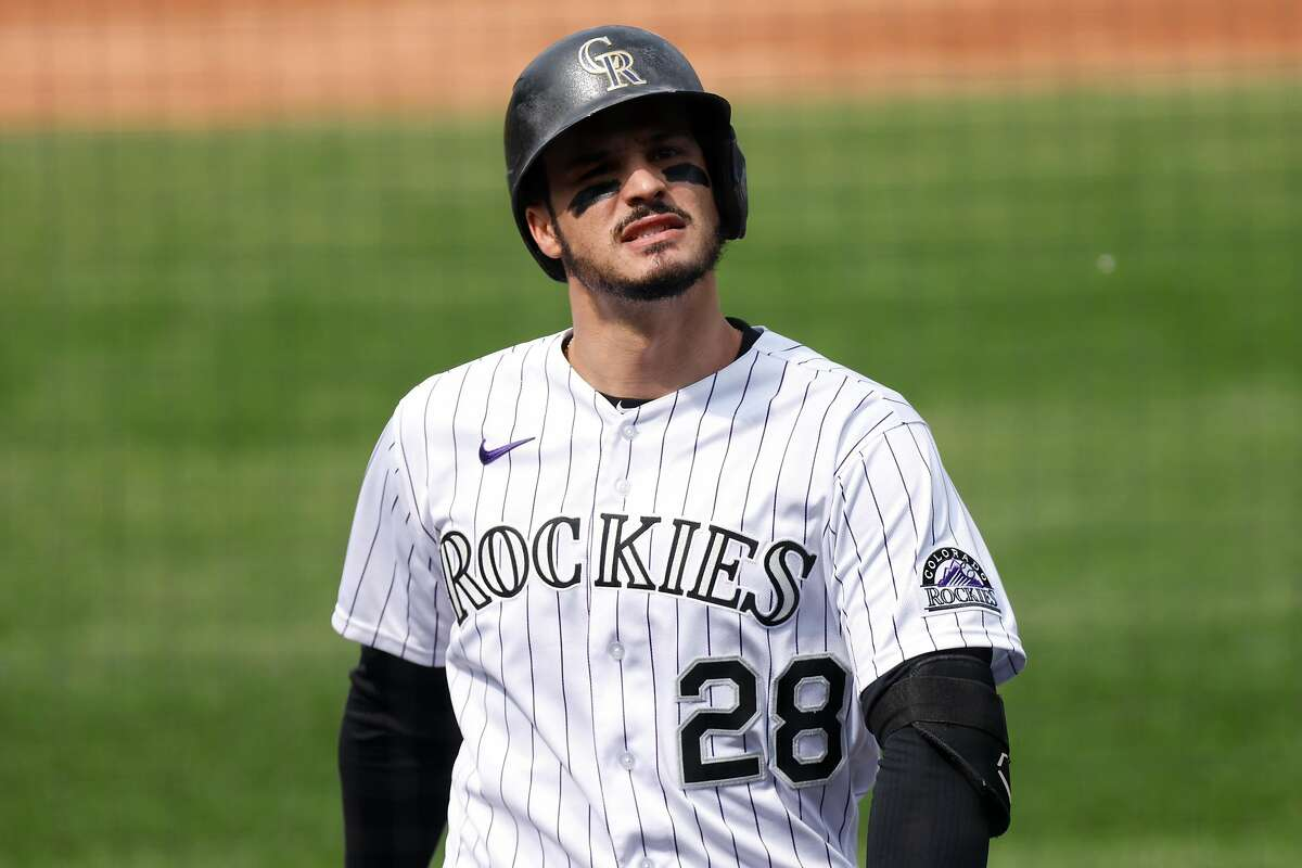 DENVER, CO - SEPTEMBER 16: Nolan Arenado #28 of the Colorado Rockies reacts while walking back to the dugout after lining out during the second inning against the Oakland Athletics at Coors Field on September 16, 2020 in Denver, Colorado. (Photo by Justin Edmonds/Getty Images)
