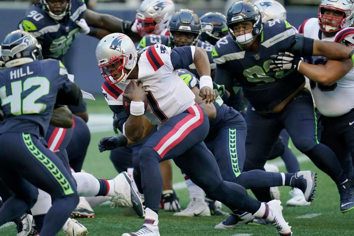New England Patriots quarterback Cam Newton (1) rushes for a touchdown against the Seattle Seahawks during the first half of an NFL football game, Sunday, Sept. 20, 2020, in Seattle. (AP Photo/Elaine Thompson)