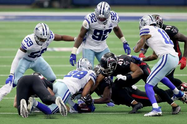 ARLINGTON, TEXAS - SEPTEMBER 20: C.J. Goodwin #29 of the Dallas Cowboys recovers an onside kick against the Atlanta Falcons in the fourth quarter at AT&T Stadium on September 20, 2020 in Arlington, Texas.