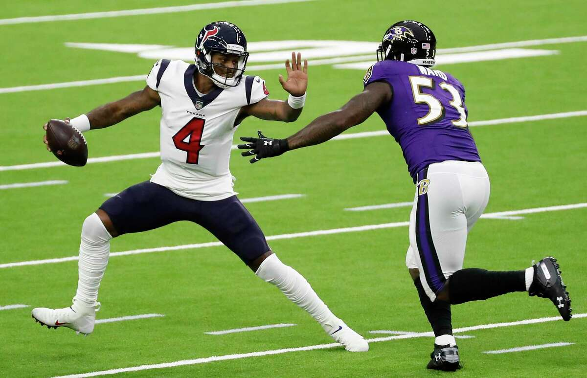 Houston Texans quarterback Deshaun Watson (4) is chased out of the pocket by Baltimore Ravens defensive end Jihad Ward (53) during the first half of an NFL football game at NRG Stadium on Sunday, Sept. 20, 2020, in Houston.