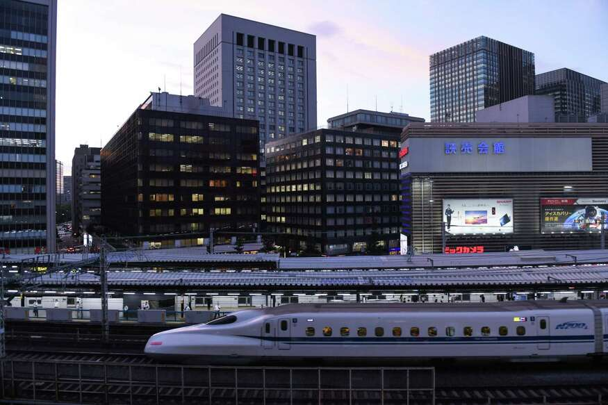 A Shinkansen bullet train travels along an elevated railway track passing Yurakucho station in Tokyo, Japan, on Sept. 8, 2020. Similar trains will operate along a planned Houston-to-Dallas line which has gained federal approval.