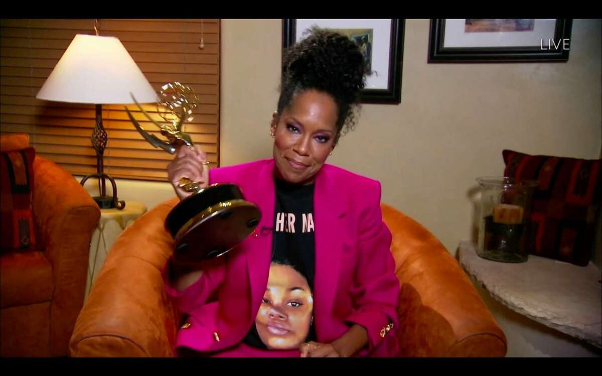 US actress Regina King wears a Breonna Taylor shirt as she wins the Emmy for Outstanding Lead Actress in a Limited Series or Movie with her role in